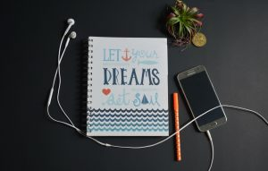 "Notebook that says Let Your Dreams Set Sail | ""Getting Started"" by Dr Carlos Garcia 